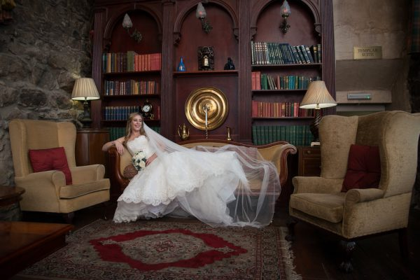Bride posing in old part of Maryculter House Hotel