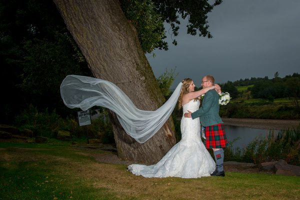 Aberdeen Wedding Photographer - Couple posing outside Maryculter House